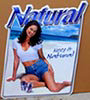 Natural Beer Girl on Beach Tin Sign